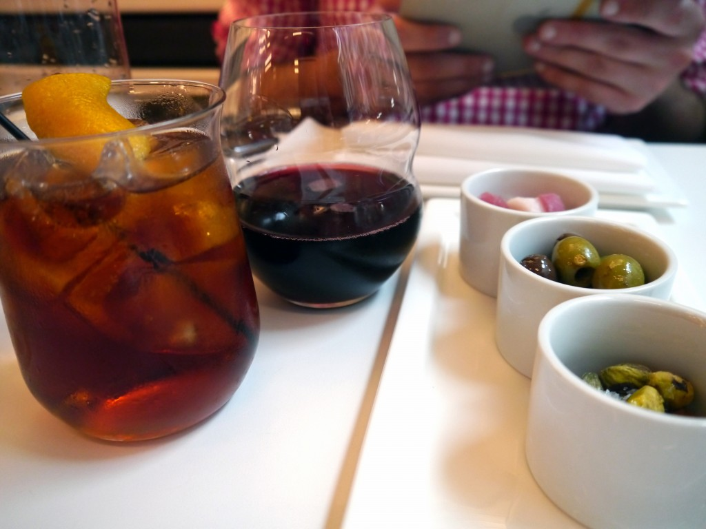 Left: Boulevardier cocktail, Gragnano wine; Right: Pistachios, Olives and Prosciutto